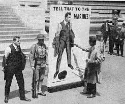 "Artist Flagg painting a ""mammoth"" image of his poster in front of the New York Public Library, August 1, 1918"